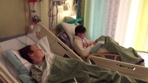 tommy in hospital bed with joseph